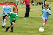 Two U6 teams chase the ball down the field. All BYSA teams are mixed. Photo Erin Perkins.